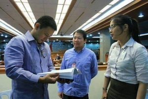 Senator Angara reading proposal from the NOI.PH team